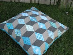 Tumbling blocks quilted pillow with aqua and linen