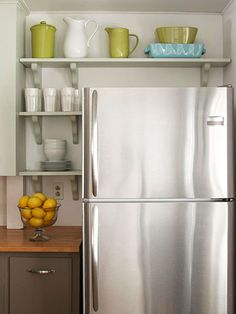 Small but Stylish Kitchen Savvy Storage Ideas Any extra storage space provides a big impact in a small kitchen. Open shelving installed around the refrigerator implemented even more storage, keeping everyday dishware within easy reach. Kitchen Corner, Kitchen Shelves, New Kitchen, Kitchen Storage, Fridge Storage, Space Kitchen, Corner Shelves, Kitchen Small, Display Shelves