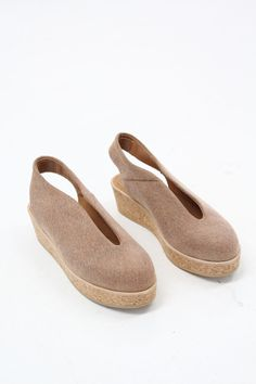 Sandy brown canvas wedge shoe with cork base and upper. Slip on style, low back strap. Leather and rubber sole, leather lined sock in soft peach. Made in the EU