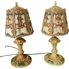 Art Deco Era heavy iron table lamps that are charming as they come.   The shades most likely had slag glass at one time but long ago were replaced