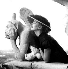 Suzy Parker, photo by Richard Avedon on the towers of Notre Dame, Paris, Harper's Bazaar, March 1951
