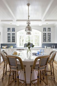 LOVE THE CEILING AND THE UTILIZATION OF MIDDLE FLOOR SPACE.  ALSO THE WINDOW IS CURVEY AND GORGEOUS.  CONSIDER BLUE SUBWAY TILE.  Are the back wall of the glass cabinets painted to match the tile?