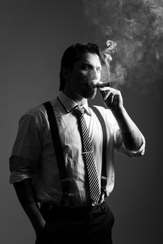 I like this photo and how the smoke is highlighted, along with the light on the person. Gangster Suit, Real Gangster, Portrait Photography Men, Dark Photography, Mature Mens Fashion, Poses For Men, Guy Poses, Cigar Men, Good Cigars