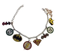 DC Comics Superheroes 9 Charm Bracelet Enamel finish on a lightweight silver tone Charm Bracelet. The Bracelet measures approx. 9 1/4 inches long. After the last charm, there is 2 inches of chain so y