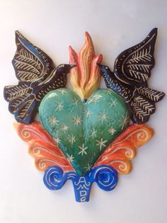 Sacred Heart Burning Blue , a Contemporary Milagro by Rachel Slick in ceramic Bead Crafts, Jewelry Crafts, Arts And Crafts, Crafting Recipes, Advanced Ceramics, Collage, Fire Heart, Arte Popular, Mexican Folk Art