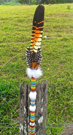 native american indian peyote beaded talking stick with australian red tail black cockatoo feather and white rabbit fur on Etsy, $175.00 AUD