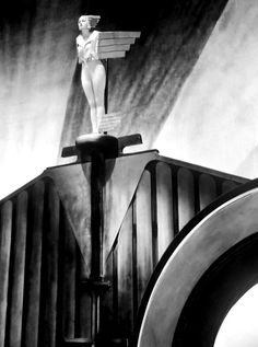 Corinne Griffith costumed as an Art Deco-style Rolls Royce hood ornament in Lilies of the Field (1924, dir. John Francis Dillon) Art direction by Milton Menasco.