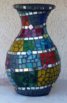 Shiny mosaic vase with glass and mirrors
