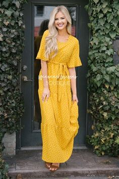 Beyond beautiful! This maxi is a summer dream come true! Beautiful canary yellow maxi dress features flutter sleeves, a gathered waist with waist tie sash and tiered maxi skirt.