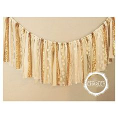 fabric garland banner is made up white, ivory, and cream fabric, lace, and gold sequin.  Torn and rag tied - edges are meant to fray.    Listed
