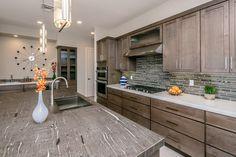 Strata Umber #glasstilebacksplash is the Perfect option for this Havasu kitchen with #quartzslab and #granite counters.https://arizonatile.com/en/products/glass/strata