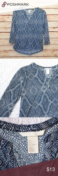 H&M Small Blue Print V-neck Blouse H&M blue and white print v-neck blouse with 3/4 sleeves, size small. 3 small buttons below neckline. Slight high-low hem, 100% polyester. Excellent condition! Smoke free home. Please see photos for measurements. H&M Tops Blouses