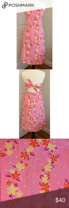 Lilly Pulitzer tie-back floral strapless dress Pink with Hawaiian-inspired pink, orange, and yellow floral print. Strapless bodice with flexible boning and inner silicone grip strip. Ties in the back. Size 8. Measurements available upon request. 100% cotton with 65% polyester/35% cotton. Excellent used condition. Lilly Pulitzer Dresses Strapless