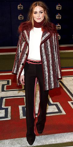 Olivia Palermo's Cute Coat Parade: Every Topper She Wore at Fashion Week | TOUCHDOWN! | In a maroon-striped coat at the football-theme Tommy Hilfiger show on Monday.