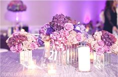 Purple roses and hydrangea make for a lovely wedding floral centerpiece combo.