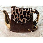 This is in my collection. :) Annie Rowe Handbag Teapot Safari (Animal Print).