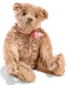 A STEIFF TEDDY BEAR, (5317,1), jointed, golden mohair, black boot button eyes, black stitching, inoperative squeaker and FF button, circa 1907 (slight fading and thinning)