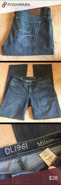 DL1961 boot cut jeans! Super cute pair of gently worn DL1961 jeans! Purchased at Nordstrom. Milano boot cut fit with Lycra four way stretch. Small pull on bottom of right pant leg, but not noticeable when worn. No wear on pant leg bottoms. Size 28. Inseam 29. Smoke free home. DL1961 Jeans Boot Cut