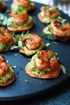 CAJUN SHRIMP GUACAMOLE BITES. 17 Small Bites for Your Next Summer Soirée #purewow #cooking #food #recipe #entertaining #summer #party #appetizer #smallbites #easyappetizers #fingerfoods #apps #summerparties #partyfood #summerrecipes