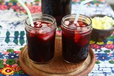 Peruvian Chicha Morada 1 (15 ounce) bag of dried purple corn 12 cups of water 3 cinnamon sticks 1 tablespoon of whole cloves 1 whole pineapple, diced (peel reserved) 1 cup white sugar 1/2 cup lime juice 1 green apple, peeled and diced