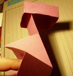 Boxkarte     Material:  ScorPal in Inch 2x 12x12 Cardstock 1 x Scrappapier Blumen doppels. Klebeband   Anleitung:  Zunächst fal...