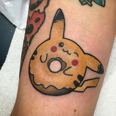 Donut Pikachu tattoo done by @xinaxiii. To submit your work use the tag…
