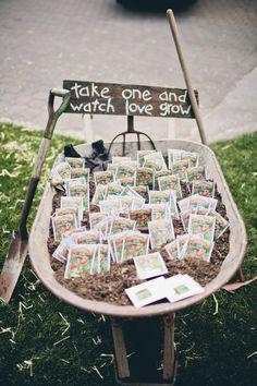 seed packet wedding favors in a wheelbarrow - darlingstuff.info  Hmm interesting something to last beyond the wedding..?
