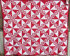 Vintage pinwheel quilt from mid 1800s. Want to make a blue and red version. Love this Vintage quilt shop at Etsy.