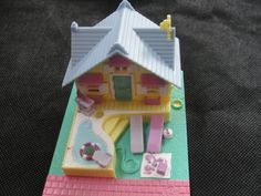 Polly Pocket House I had this when I was little and I absolutely loved it! It was a pool party beach house. As an adult, I wish I still had it. I really want the Wizard of Oz Polly Pocket collection.