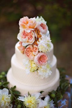Get a plain cake and ask your florist if they'll arrange your matching flowers on the cake the morning of.. #flowercakes