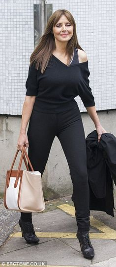 Carol Vorderman looks slim in Fame inspired off-the-shoulder top and spray on jeans   Mail Online