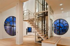 In addition to having the sweeping views of Brooklyn and lower Manhattan through the four 14-foot glass clock windows (each electronically synchronized), the apartment has an elevator leading up to the master suite and a glass roof terrace with a 400-square-foot open terrace space.