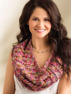 "Wear this chic accessory as a cowl or pretty shoulderette.   Dropped stitches make variegated yarn pop in this circular cowl. Knit with 5 balls of Tahki Yarns Tandem using U.S. sizes 5/3.75mm and 7/4.5mm 24"" circular needles. Finished size is 13..."