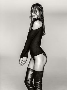 Kendall Jenner. Wet & Wild in thigh high boots.