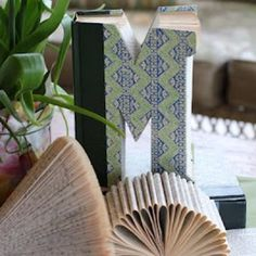 Monogram made from an old book - I think it's cool and would love to have one, but I have a little problem with cutting up a book!
