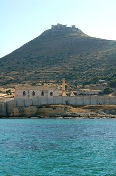 Aegadian Islands| Isole Egadi   Favignana, Sicily Italy ~ Clear Blue Waters with Historic Port Architecture and a view of Castello Santa Caterina