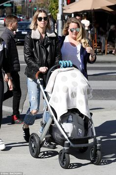 Whitney Port pushes stroller while she runs errands  Shes a television personality fashion designer and author.  And Whitney Port is finding a way to fit being a mom into her busy routine as she ran errands in Beverly Hills on Friday while pushing six-month-old son Sonny Sanford in a stroller.  The Hills alum wore a leather jacket and distressed jeans for the outing.  Hectic: Whitney Port is finding a way to fit being a mom into her busy routine as she ran errands in Beverly Hills on Friday…