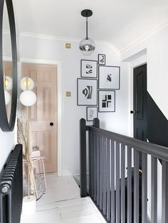 Love the black banister with the nude pink door Black And White Hallway, Black Door, Black Banister, Painted Banister, White Floorboards, Painted Floorboards, Narrow Hallway Decorating, Tiled Hallway, Pink Hallway