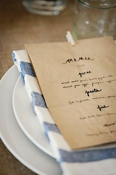 Menu + navy striped cloth napkin LOVE this.....add these little wooden clips for seed packets on table assignment baskets- eggs blue birds