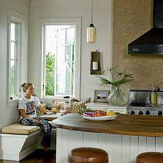 banquette, casement windows, reclaimed wood counters