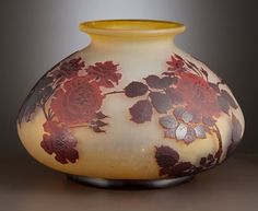 Miscellaneous, EMILE GALLE. Vase patterned with wild roses in reds over shadedlemon ground, circa 1900. Marks: Cameo signature. 8 inches (...