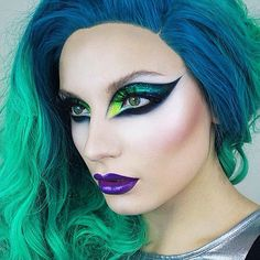 Penelope Gwen Drag Makeup Green and Yellow Eyes Purple Lips