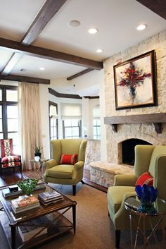 #1Fireplace:  Like the rounded raised hearth, arched opening with decorative/accent row of stone above it, wood beam mantel with corbel/chunk support & stone going all the way to ceiling. Want different stone.