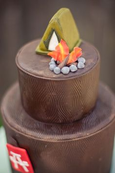 camping cake - love the bark effect!! Add a canoe, truck, guitars, chairs,water, big rocks, and a little camp site sign that says 35 for age.  :)