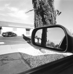 Las Vegas, 1997, gelatin-silver print - This photograph is part of approximately fifty photographs that are part of a portfolio and exhibition called 'America by car' made by Lee Friedlander. Friedlander took these photographs over a period of a decade in a majority of Americas fifty states. I really like these photographs because of how Friedlander shows different places in America from the seat of his car. I also like how he's used the car mirror to show part of the location behind him.
