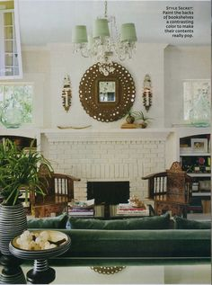 Peacock Mirror, fireplace mantel painted white, sconces