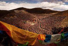 Tibetan prayer flags flutter on a hillside above the Larung Wuming Buddhist Institute on Oct. 30.