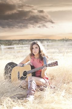 high school senior girl with guitar at sunset