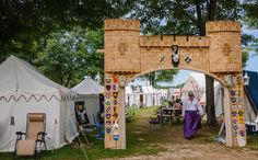 A creative gate to one of the Pennsic Campsites - I like how the heraldry of those in the camp is on the gate.