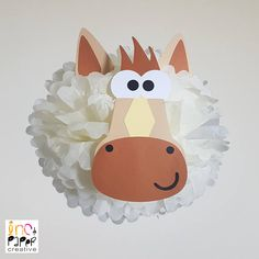 Having a farm or barnyard themed event? No need to horse around with any other decorations. This horse pompom is for you! Designed to hang above your dessert table with our other farm animals, choices include a pig, cow, chicken, sheep, and more. Perfect for a 1st birthday, baby